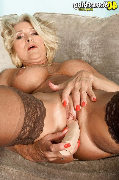 Mature fairy spreading her stockinged legs to insert a toy into her drenched cunt