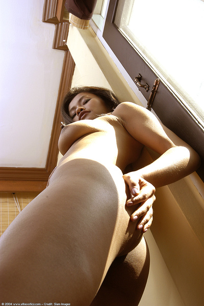 Young Japanese chicito shedding underware and petticoat whereas undressing
