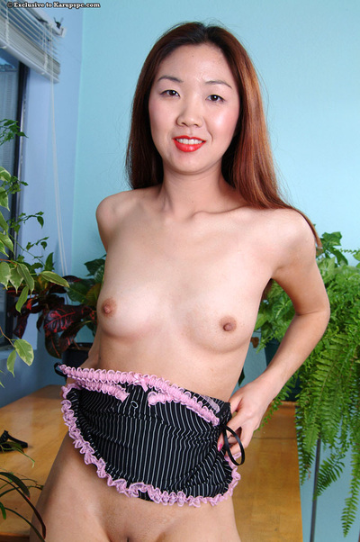 Close up posing of an infant Oriental youthful Heidi Ho in high heels