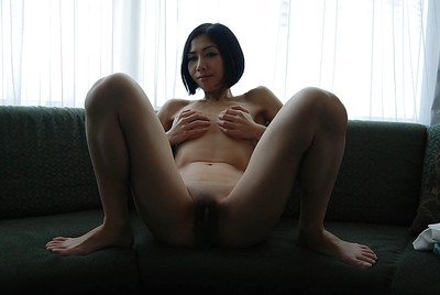 Slight Japanese MILF undressing and demonstrating her sodden pussy in close up