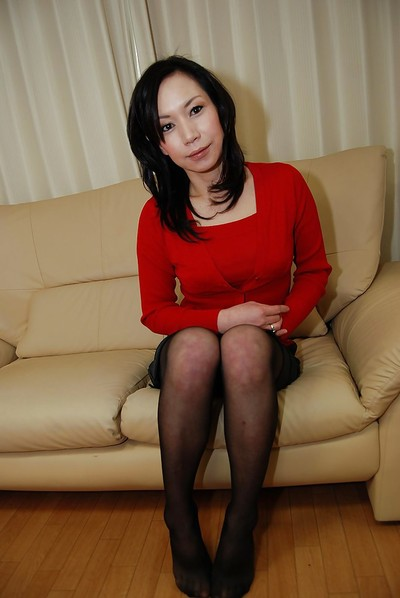 Raunchy Japanese MILF in cylinder undressing and expanding her bushy gash