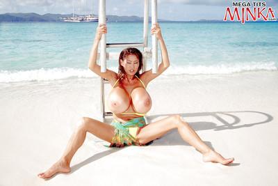 Eastern beach dear Minka unleashing intense MILF milk cans from bikini outdoors
