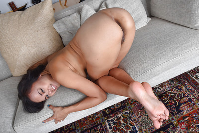 Oriental solo cutie Annie Cruz revealing little MILF love bubbles and curly pussy
