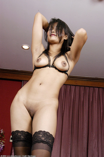 Young dark brown lass showing off major bra buddies and skinhead Eastern snatch in