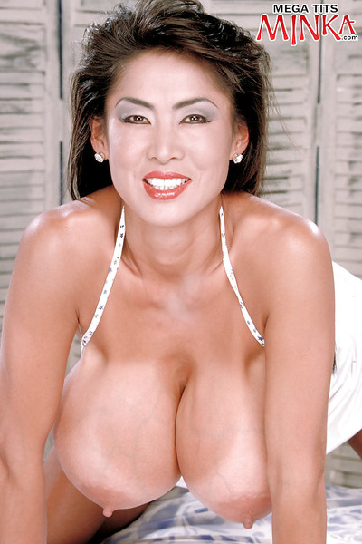 Solo Oriental doll Minka showing off bully bazookas and furry muff