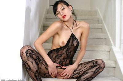 Youthful Oriental dear exposing swollen pussy lips in crotchless bodystocking
