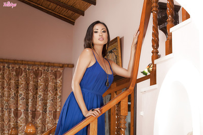 Oriental pornstar Beverly is posing in her splendid blue costume and