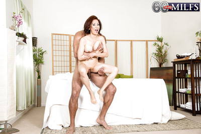 Japanese gran Kim Anh giving damp oil massage in advance of riding pecker cowgirl style