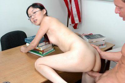 Small Chinese coed in glasses removes clothes and obtains pounded tough on the desk