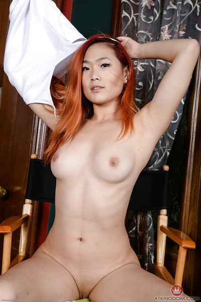 Teen redheaded Chinese cutie Lea Hart revealing skillful titties and skinhead snatch
