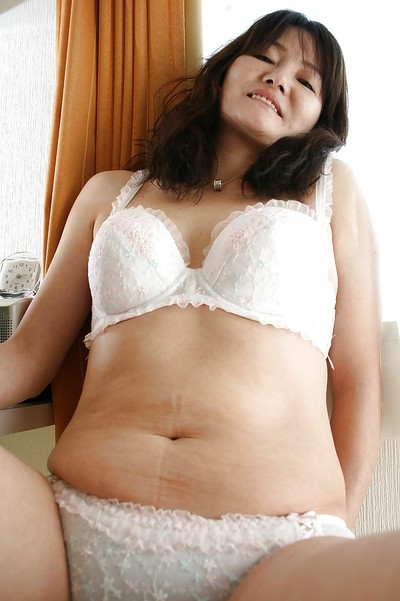 Oriental MILF Michiko Sudo undressing and vibing her trimmed vagina