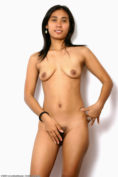 Teen Oriental darling revealing insignificant meatballs and shaggy love-cage afterward undressing