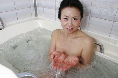 Melodious oriental lassie Junko Sakashita exposing her pink slit subsequently bathroom