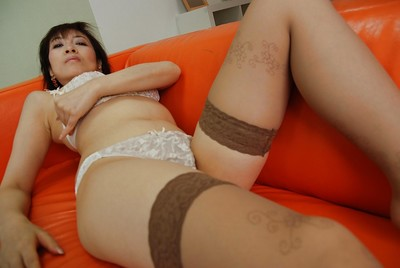 Oriental MILF Shinobu Yabe undressing and exposing her gentile in close up