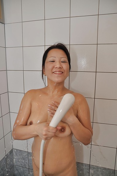 Eastern MILF with hirsute cooter and shapely whoppers Kumiko Katsura charming shower-room