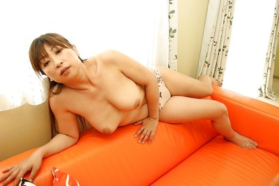 Oriental seasoned lady Nozomi Oshima undressing and exposing her bawdy cleft in close up