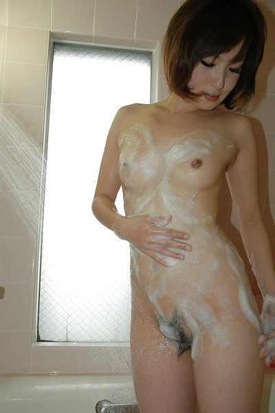 Smiley Chinese amateur Kazumi Shindou has some foamy satisfaction in the baths