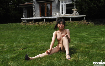 Stripped oriental queen with little milk sacks and curly fur pie having getting joy outdoor