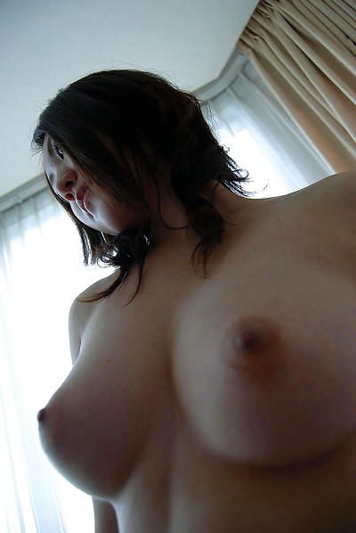 Japanese amateur in hose undressing and exposing her bushy gash in close up