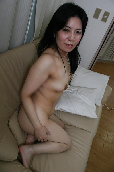 Smiley Japanese melodious lady undressing and teasing her unshaved gash