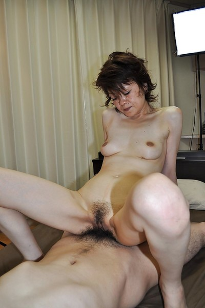 Oriental lady gives a fellatio with hirsute sack licking and acquires her hirsute cum-hole nailed