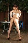 Leggy youthful Oriental gal striptease outdoors to undressed bushy slit