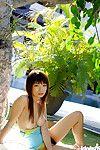 Oriental coed Hikari Hino revealing her faultless bosoms and wavy slit outdoor