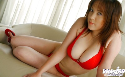 Alluring eastern girl with colossal titties erotic dance off her red underclothes