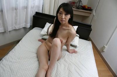 Stripped oriental bombita demonstrating her unshaved hottie pot in close up