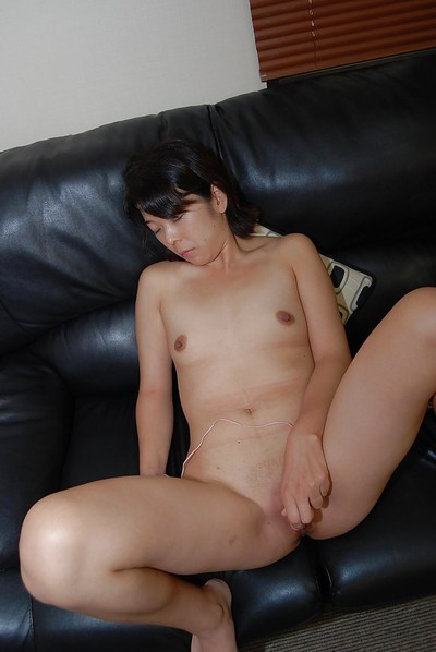 Shy oriental MILF with little boobs getting unclothed and vibing her bald gash