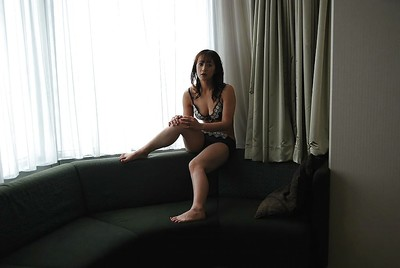 Eastern MILF Maiko Hirota undressing and posing undressed on the mattress