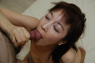 Oriental MILF Shinobu Yabe gives head and purchases her shaggy slit cocked up