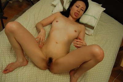 Oriental MILF gives head and has some fur pie toying and very joy
