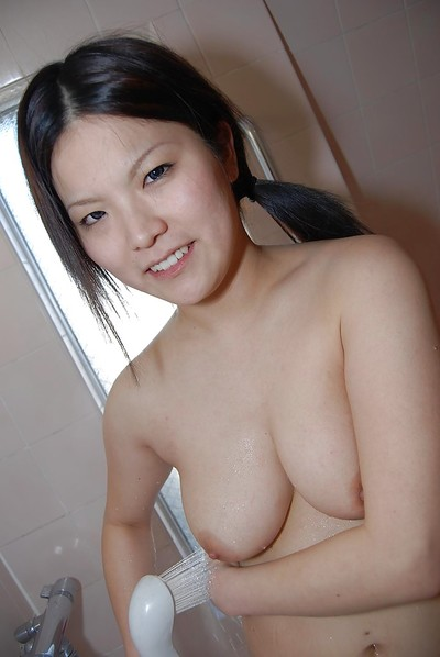 Smiley Japanese queen lovely bathroom and teasing her trimmed gash