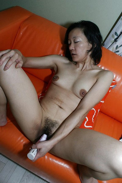 Japanese MILF Aya Sakuma undressing and toying her  gentile