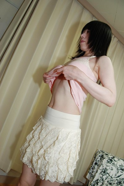 Shy Japanese bombita with bushy pubis gets undressed down and has some gentile vibing liking
