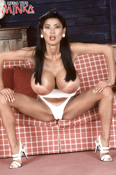 Chinese MILF doll Minka fondling severe juggs in underwear and high heels