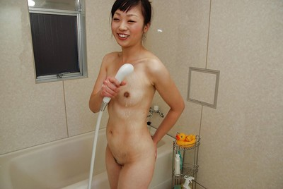 oriental model Tomomi Sone enchanting washroom and exposing her goods in close up