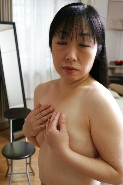 Sassy Japanese MILF Fumiko Manaka undressing and showcasing her  wet crack