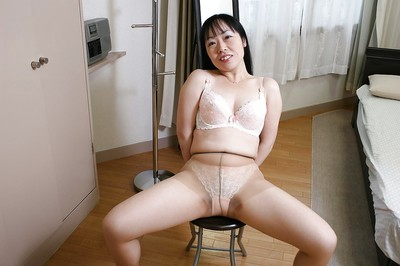 Sassy Japanese MILF Fumiko Manaka undressing and showcasing her  wet crack