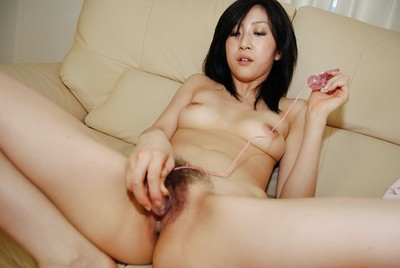 Slutty Chinese MILF with curly pubis has some bawdy cleft vibing getting pleasure