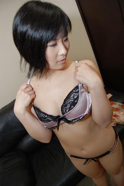 Oriental darling Minori Nagakawa erotic dancing down and exposing her hirsute gentile