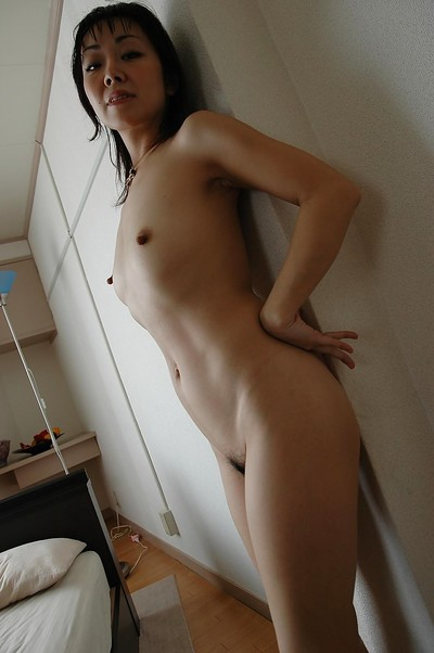 Energetic japanese MILF idly gains rid of her  and sexy pants