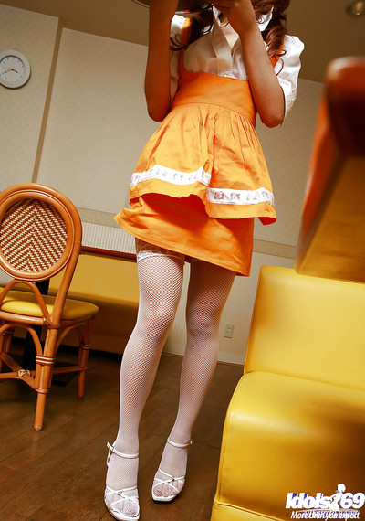 Saori Harada uncovering her diminutive milk sacks with intense teats and flashing her bush
