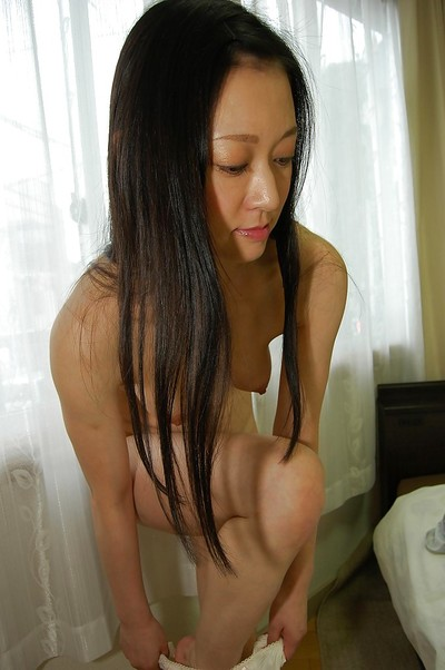 Shy Japanese lady with curly cooter listlessly uncovering her fuckable stoops