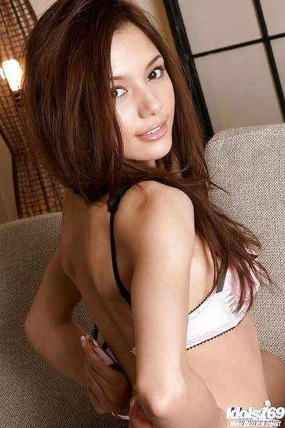 Appealing oriental young with shaggy cage of love striptease off her clothing and underware