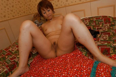 Short-haired Japanese MILF Kyoko Nogi undressing and widening her legs