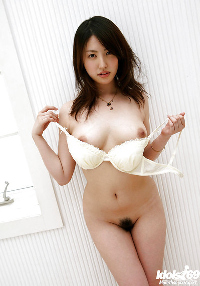 Seductive eastern hotty Takako Kitahara slipping off her clothing