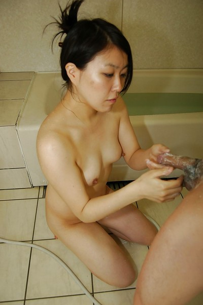 Chinese wench gives a soapy cock stroking and a fleshly nooky in the bathroom