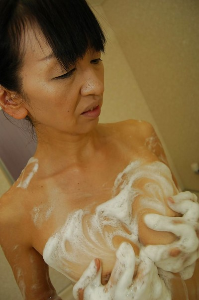 Slippy Japanese lady Yoshiko Nagasawa engaging shower-room and caressing she is